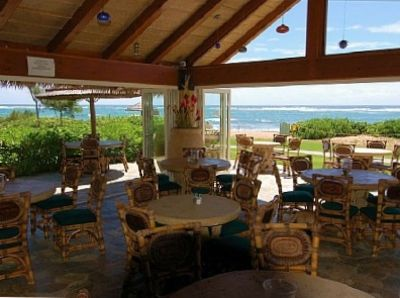 Tahitian Lanai bar and grill serves beach and pool. Live music nightly.