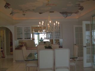 Vacation Homes in Marco Island house photo - Dining room with custom painted ceiling provides unmatched ambience.