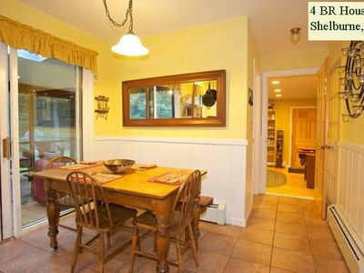 KITCHEN: has casual seating for 4 people. On the left you can see the porch.