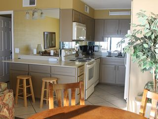The Summit condo photo - The kitchen is newly remodeled and includes stone counter tops.