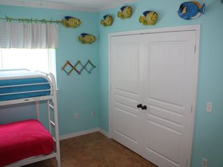 Pensacola Beach condo photo - Kids friendly decorated room with DVD player and flat screen TV