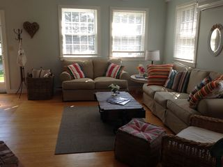 Living room: sofa & love seat, ceiling fan, in-wall AC, cable TV/DVD, wood s