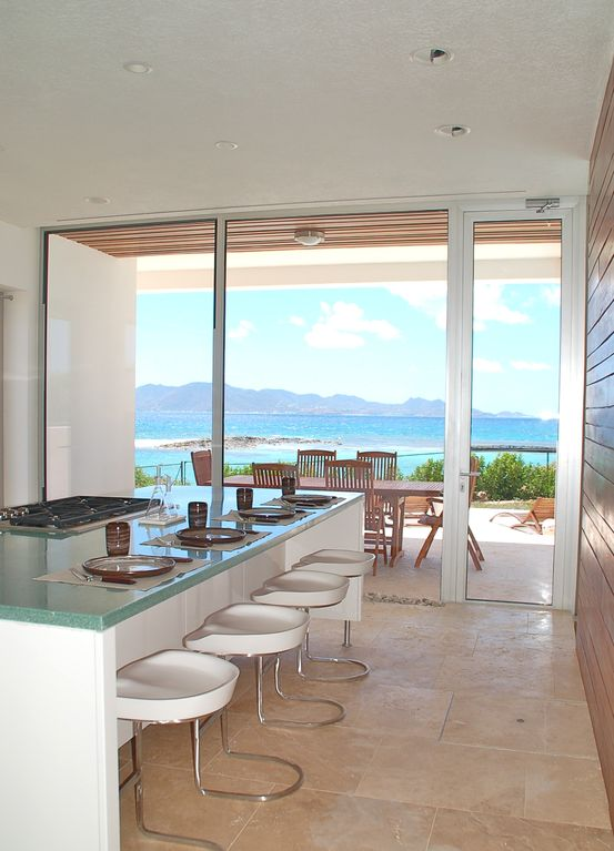 Kitchen has ocean views and a 4 person breakfast bar