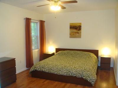 Lower level master bedroom with a king bed and private exit to lower deck