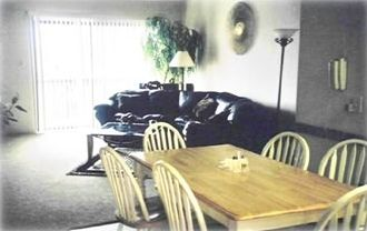 Dining area, opens up to living room with woodburning fire place,outside deck