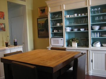 Kitchen with Open Cabinetryand Butcher Block Island
