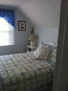 Third bedroom with double bed on second floor.