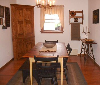 dining room, corner cupboard, long table