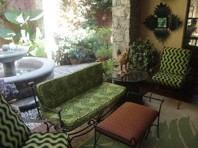 A seating area in the main floor patio