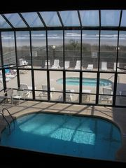 Crescent Beach condo photo - View from Exercise Room overlooking pool, hot tub & Beach