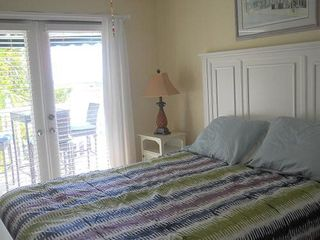 Key West condo photo - Master bedroom overlooks the deck and ocean.