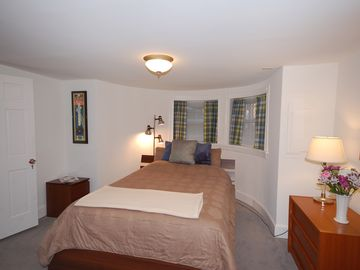 The bedroom is located at the front of the apartment-- Queen sized bed