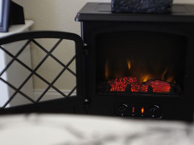 Carova house rental - electric fireplace in romantic top floor bedroom can be set w/wo heat.