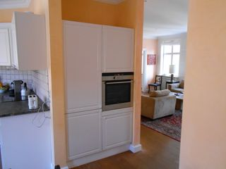 Stroget apartment photo - Refligerator and below, Freezer (build in), Microwave Oven, Conventional Oven