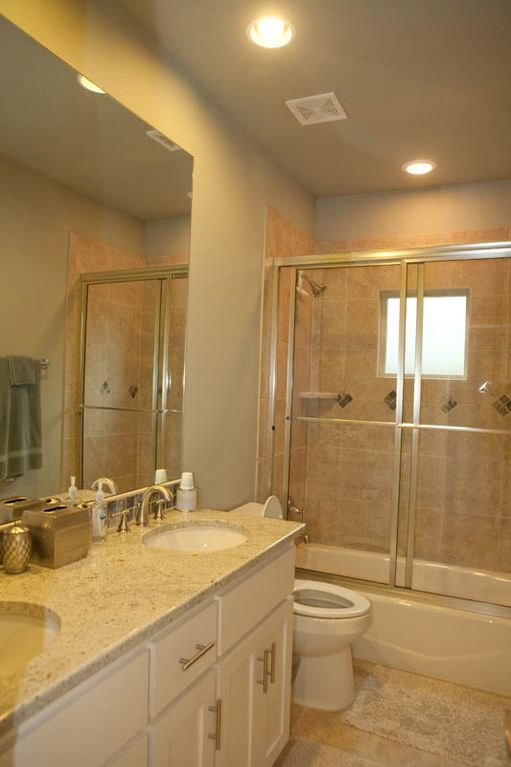Large 2nd Bath, dual sinks, tub/shower combo, mosaic tile, granite/travertine