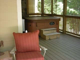 Helen cabin photo - Top of the line Hot tub placed in a VERY private area on porch