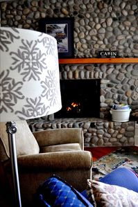 River rock fireplace in the main living area.