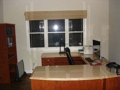 office with i Mac computer, laser printer, and WiFi