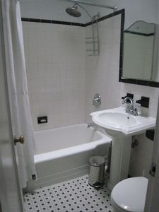 One of three renovated bathrooms