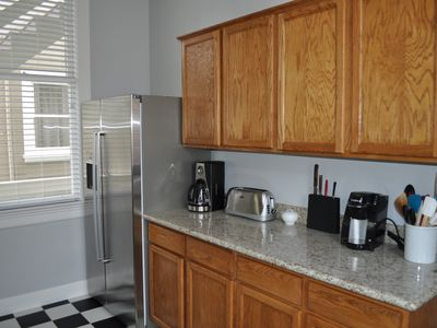 Kitchen includes granite counter tops and stainless steel pots and pans