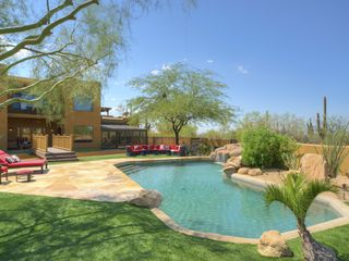 Scottsdale house photo - backyard features huge pool, several seating area, covered ramada & fireplaces
