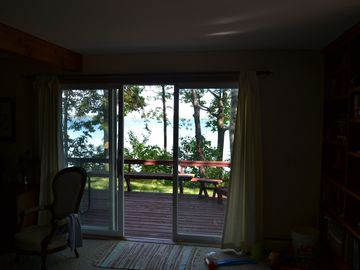 Looking out to front deck from dining room.