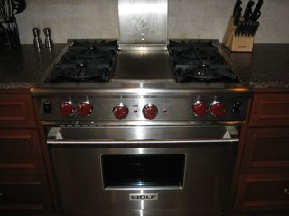 Inlet Beach townhome photo - Wolf gas stove with grittle/grill.