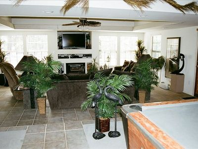 Large living area with flat screen TV and DVD