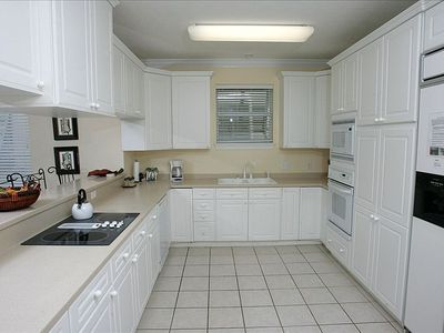 Large OPEN kitchen area with serving bar and plenty of cabinet storage space
