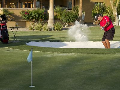 Enjoy the property's private Putting Green, complete with Sand Trap