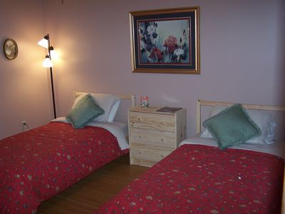 Comfortable twin beds with Laura Ashley duvet covers and lovely artwork