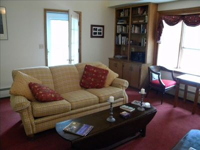 Large living room with access to front porch and views of Keuka Lake