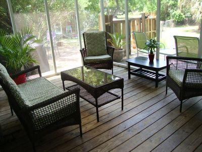 Aww.. the back porch. Beverage, anyone? Fenced yard and patio w/ grill.