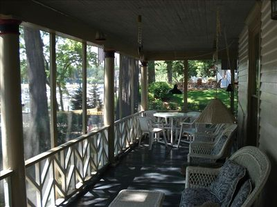 L-Shape screen porch with view of Black River Marina and Lake Michigan