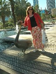 Kelowna house photo - Jo, petting the black swan sculpture in W.A