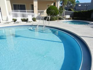 Sun Lake condo photo - Heated swimming pool with hot tub in background.