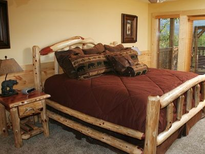 Beautiful King Log Bed in Lower Level Bedroom with Deck Access and View
