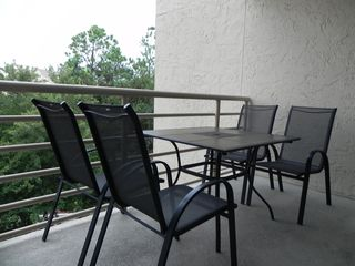 Palmetto Dunes condo photo - Balcony #1 seats four for meals, or for reading the paper with morning coffee.