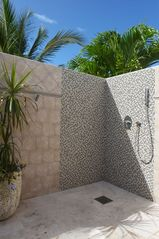 Orient Bay villa photo - example outdoor shower that each suite offers