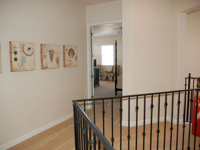 Double entry doors to Masterbed rooms, open floor plan, wide halls + fun art
