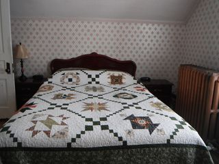 Crowsnest Pass house photo - One of the quaint, old-fashioned bedrooms.