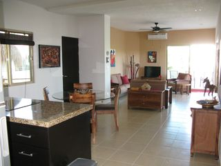 Tulum condo photo - Granite countertops. Bosch cooktop and oven. Stainless fridge.