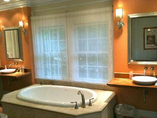 Atlanta house photo - Master bathroom with Italian design light fixtures, shower & bath