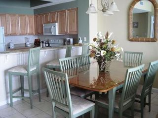 Dining area with bar and plenty of seating - Majestic Sun condo vacation rental photo