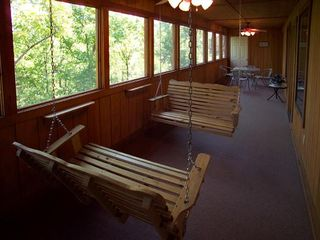 Branson cabin photo - Double porch swings on the screened porch, everyone's favorite spot.