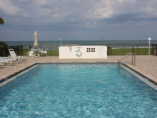 New Smyrna Beach townhome photo - View of pool looking East with the ocean as a backdrop.