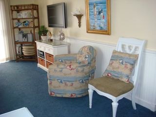 Surfside Beach condo photo - Living area showing flat screen TV, DVD, CD player and Wireless HiSpeed Internet