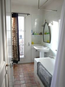the bathroom, with full-sized bath and power shower