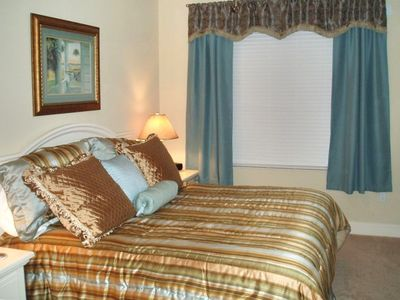 Beautifully decorated Master Suite with TV/DVD & comfortable king size bed.