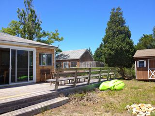 View shows outbuildings with outside shower area. Kayaks are included in rent - East Hampton cottage vacation rental photo
